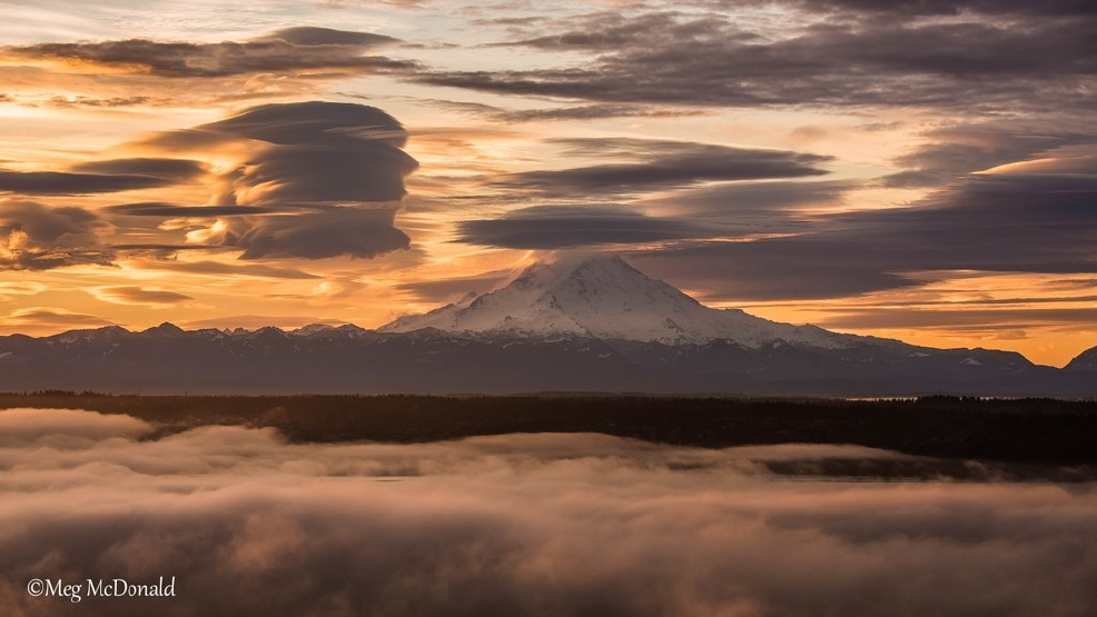 Photos: Sunrise brings spooky clouds to Mt. Rainier